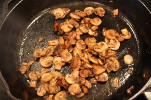 Add olive oil and butter to pan; add mushrooms and then Vermouth.