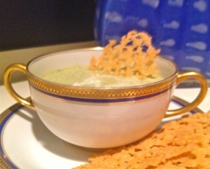 Creamy zucchini soup with parmesan crisps