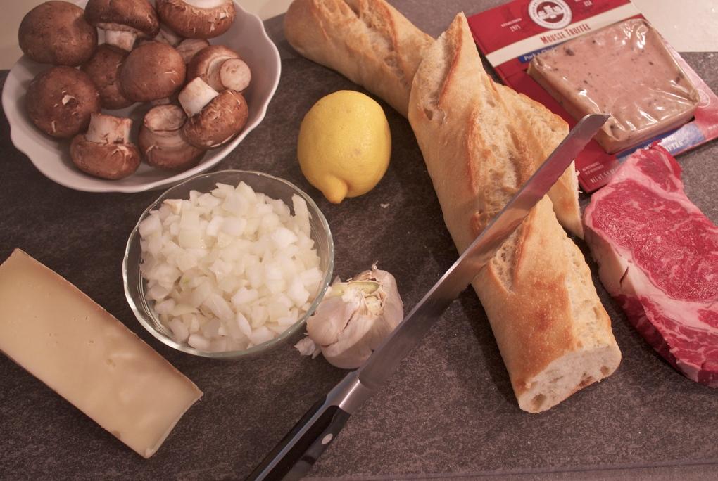 Steak, onions, mushrooms, pate, baguete, lemon, garlic, and more... the start of a great Beef Wellington Bite!