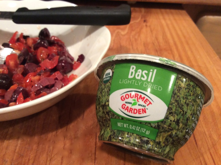 A handy-size container of freeze dried basil so I have it when I need it.